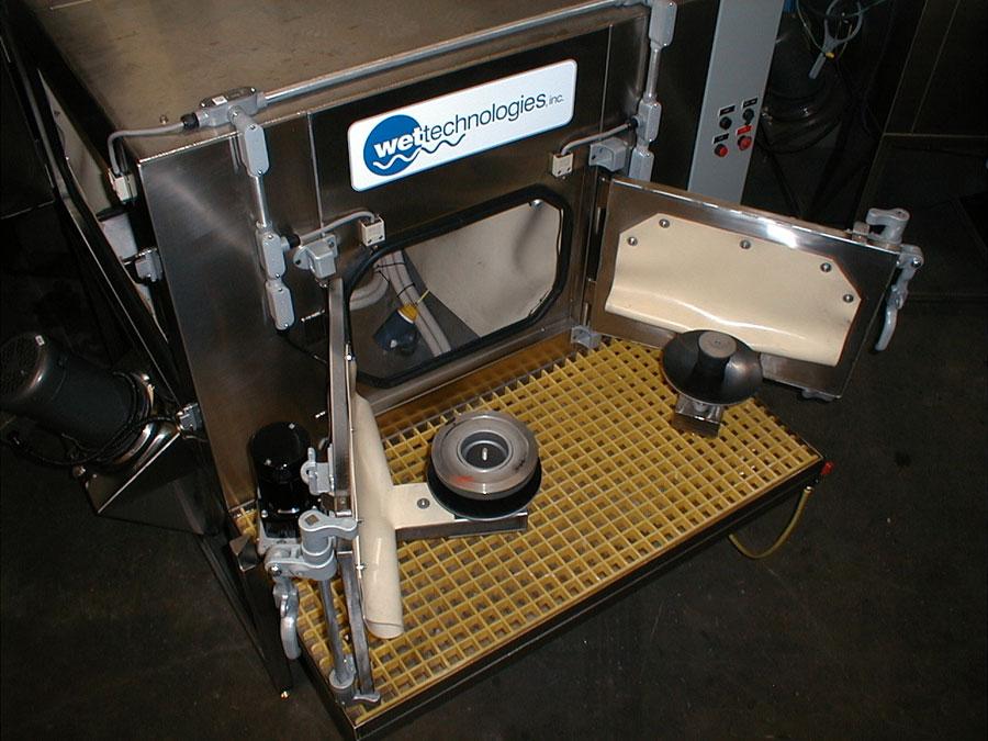 Wet blasting machine loading