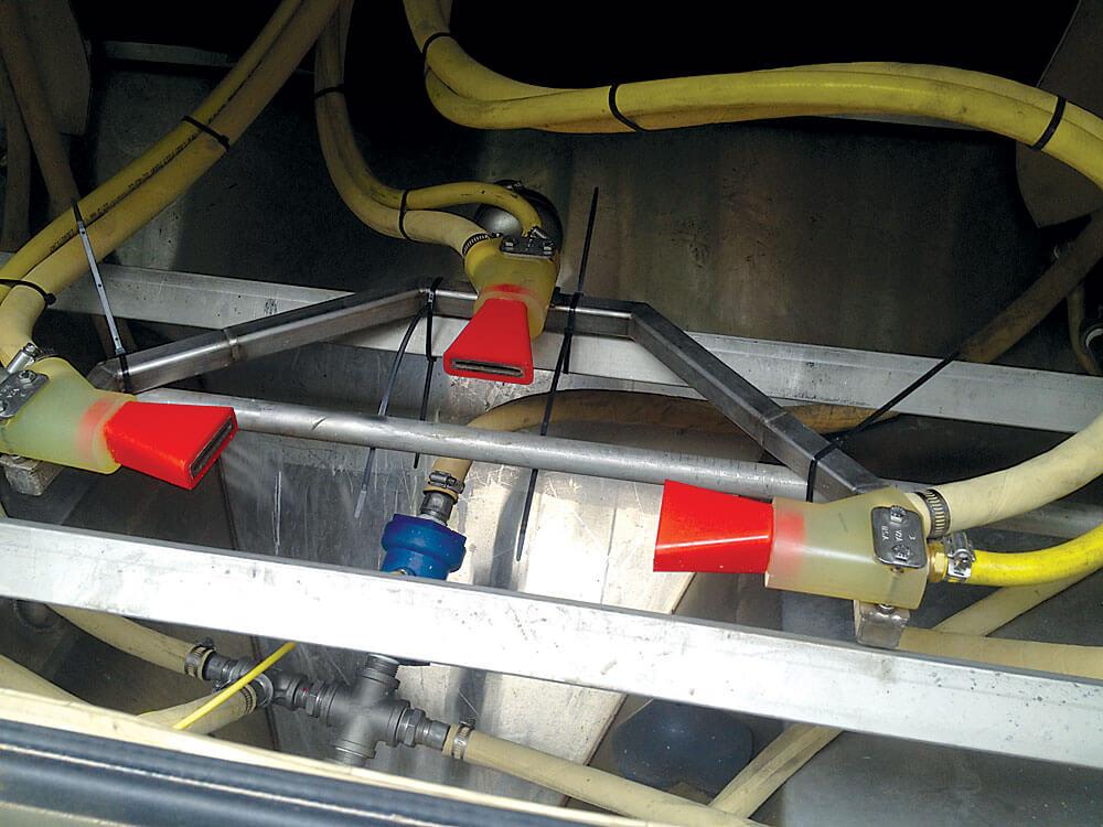Robotic wet blast inline system