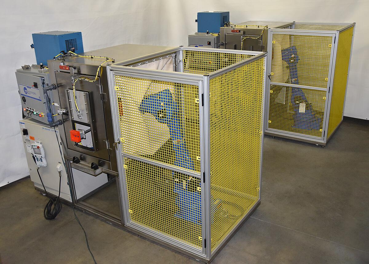 Wet-slurry blast machines clean aircraft engine vanes after laser hole drill process.