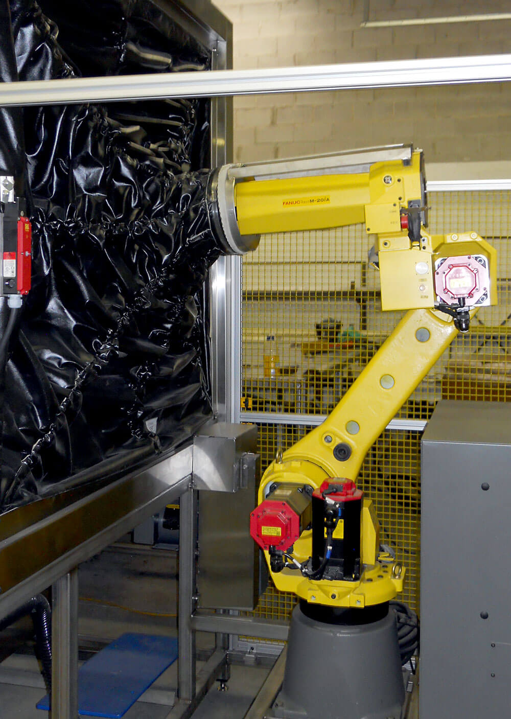 Six axis Fanuc Robot integrated with wet blasting system. Client: Pratt.