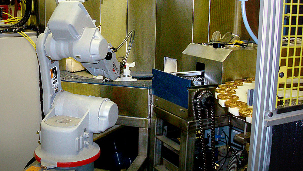Fully automated, six-axis robotic pick and place system for loading, descaling, rotating, rinsing and unloading commemorative coins. Client: US Mint